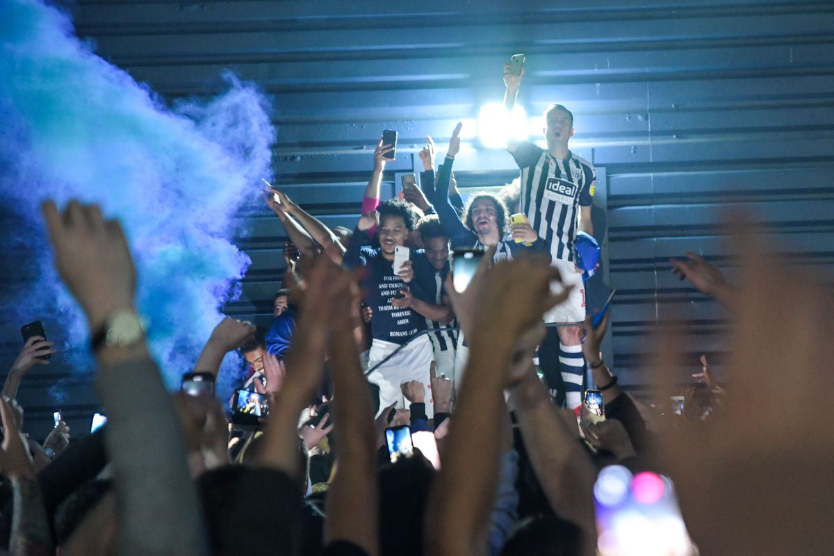 West Bromwich Albion players celebrate with supporters at The Hawthorns. Photo: SnapperSK