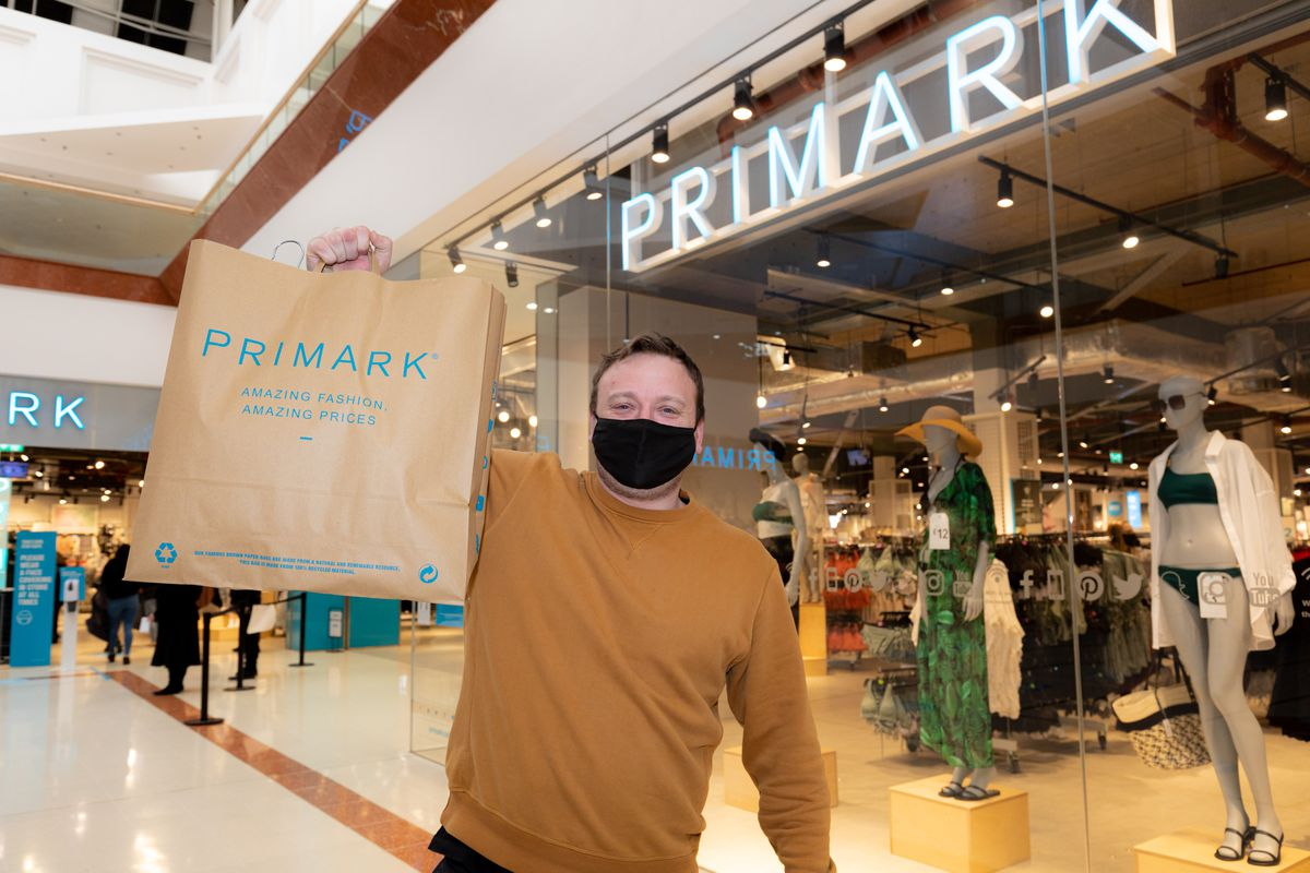 Grant Harper from Kingswinford was the first shopper to snap-up a bargain from Primark at Merry Hill. Picture by Shaun Fellows / Shine Pix Ltd
