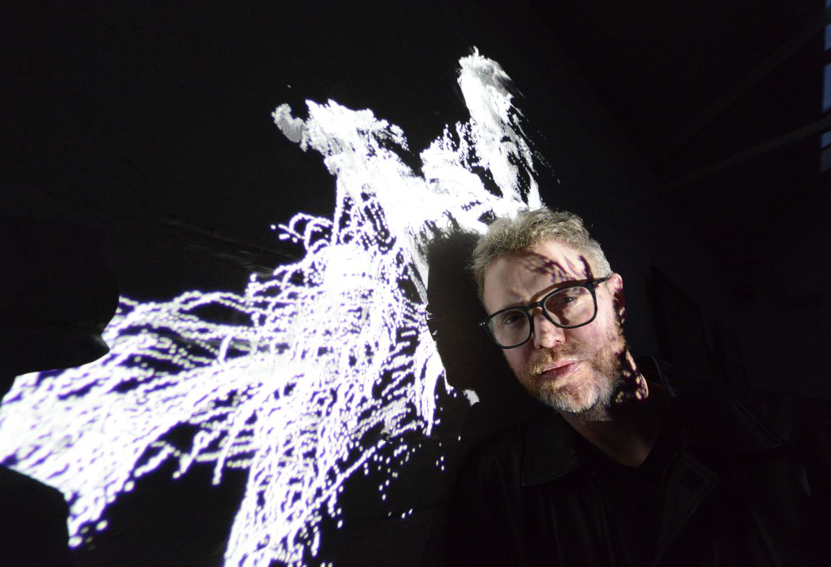 Graham Everitt pictured with his 3D laser artwork
