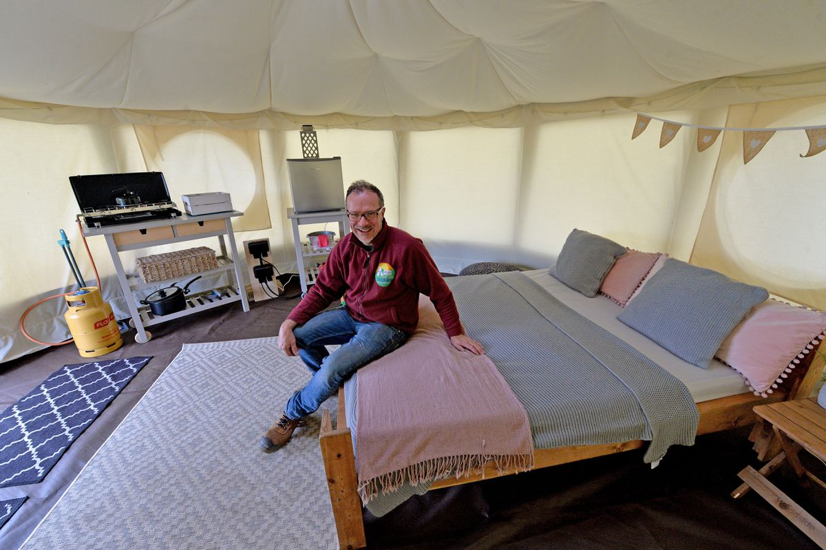 Owner Justin Hopley shows off one of the yurts on site. He said he was apprehensive, but also excited about the period coming up for the site