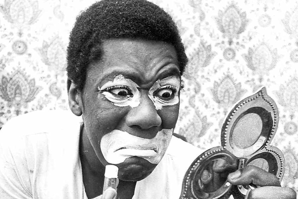 The photo shows sir lenny painting his face before appearing in the controversial black and white minstrel show in the late 1970s