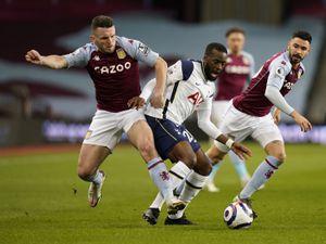 Aston Villa's John McGinn (left) and Tottenham Hotspur's Tanguy Ndombele (centre)