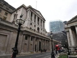 Bank holds rates at 0.5%, but moves closer to a hike