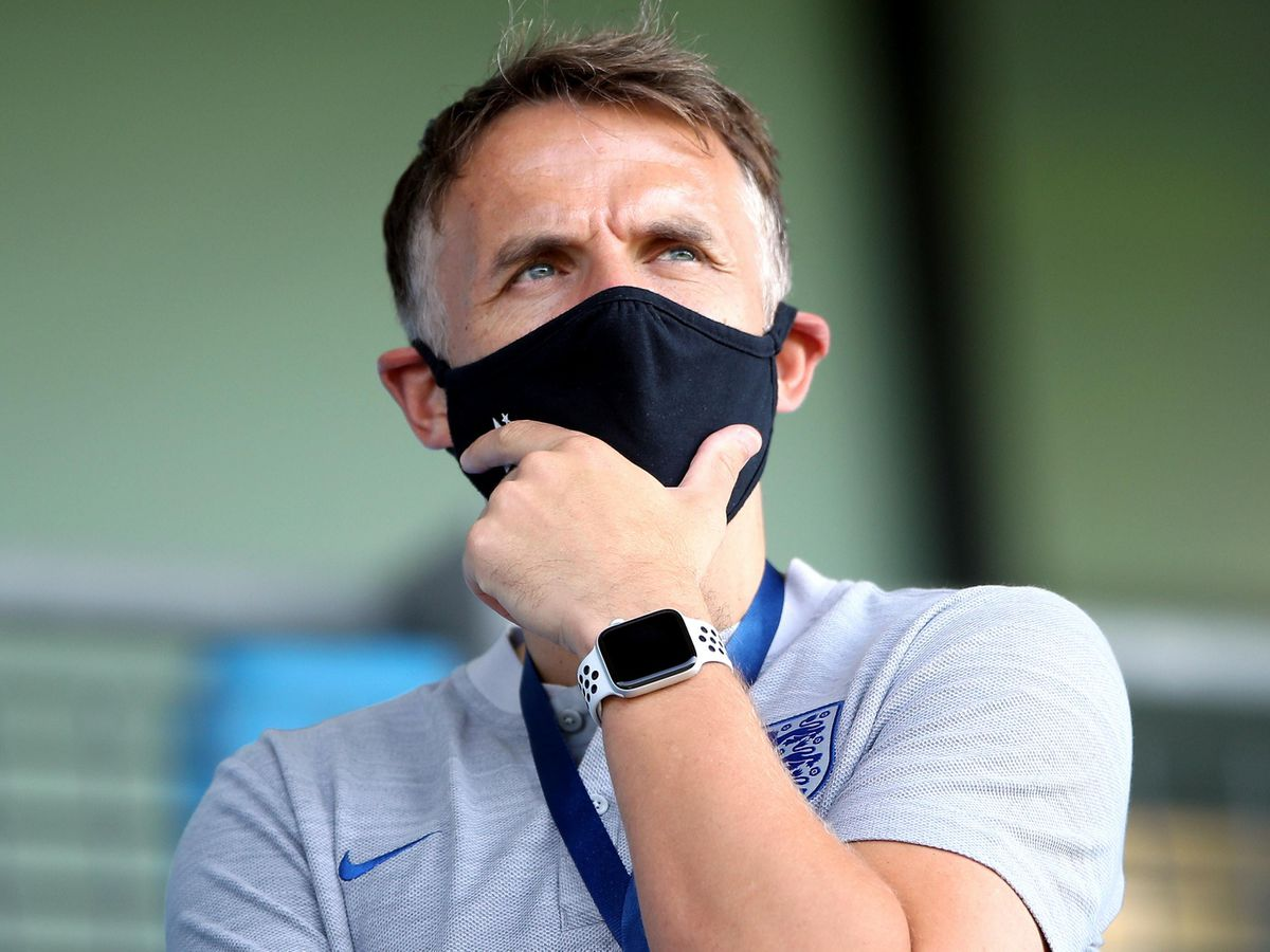 Phil Neville will not be able to take England Women to Germany next week after a positive test within the camp