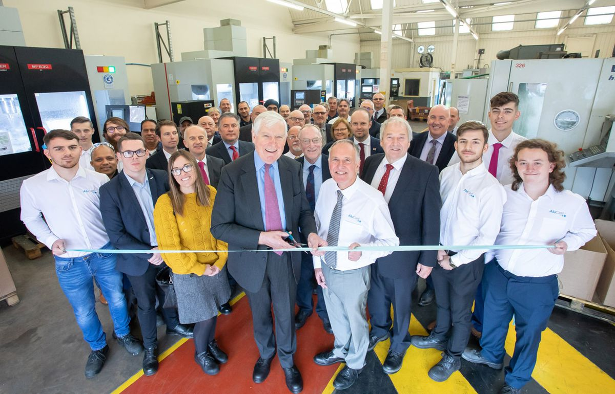 Lord Carrington opens the new machine shop with Tony Sartorius