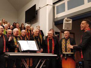 Lichfield Godspel Choir and its Musical Director Themba Mvula.