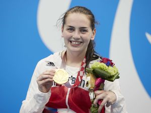 Handout photo dated 26/08/2021 provided by ParalympicsGB/imagecomms of Great Britain's Tully Kearney poses with her gold medal after winning the women's 100m Freestyle S5 during day two of the Tokyo 2020 Paralympic Games at the Tokyo International Forum in Japan. Picture date: Thursday August 26, 2021. PA Photo. See PA story PARALYMPICS Swimming. Photo credit should read: Photo credit should read: imagecomms/ParalympicsGB/PA Wire.   NOTE TO  EDITORS: This handout photo may only be used in for editorial reporting purposes for the contemporaneous illustration of events, things or the people in the image or facts mentioned in the caption. Reuse of the picture may require further permission from the copyright holder.