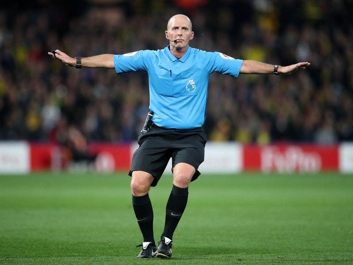 Mike Dean referees a Premier League game