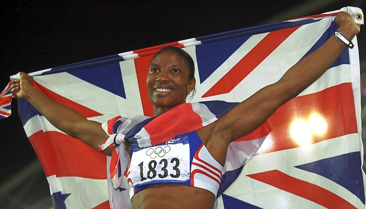 Great Britain's Denise Lewis celebrates winning the Gold medal in the Women's Heptathlon at the Olympic Games in Sydney today, Sunday 24th September 2000. PA Photo : John Giles.