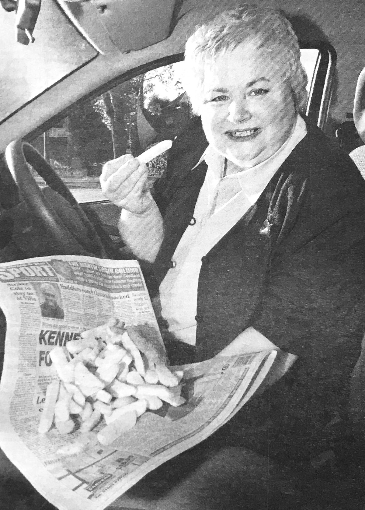 Janet with her newspaper-wrapped fish and chips