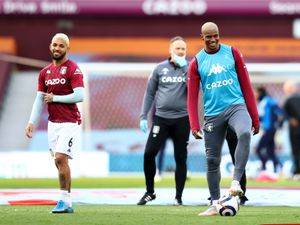 """Aston Villa's Wesley (right) warming up before during the Premier League match at Villa Park, Birmingham. Picture date: Sunday April 25, 2021. PA Photo. See PA story SOCCER Villa. Photo credit should read: Michael Steele/PA Wire.   RESTRICTIONS: EDITORIAL USE ONLY No use with unauthorised audio, video, data, fixture lists, club/league logos or """"live"""" services. Online in-match use limited to 120 images, no video emulation. No use in betting, games or single club/league/player publications."""