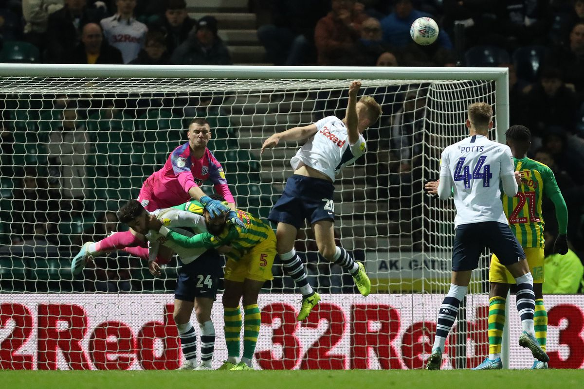Sam Johnstone of West Bromwich Albion clears the ball from Jayden Stockley of Preston North End (AMA)