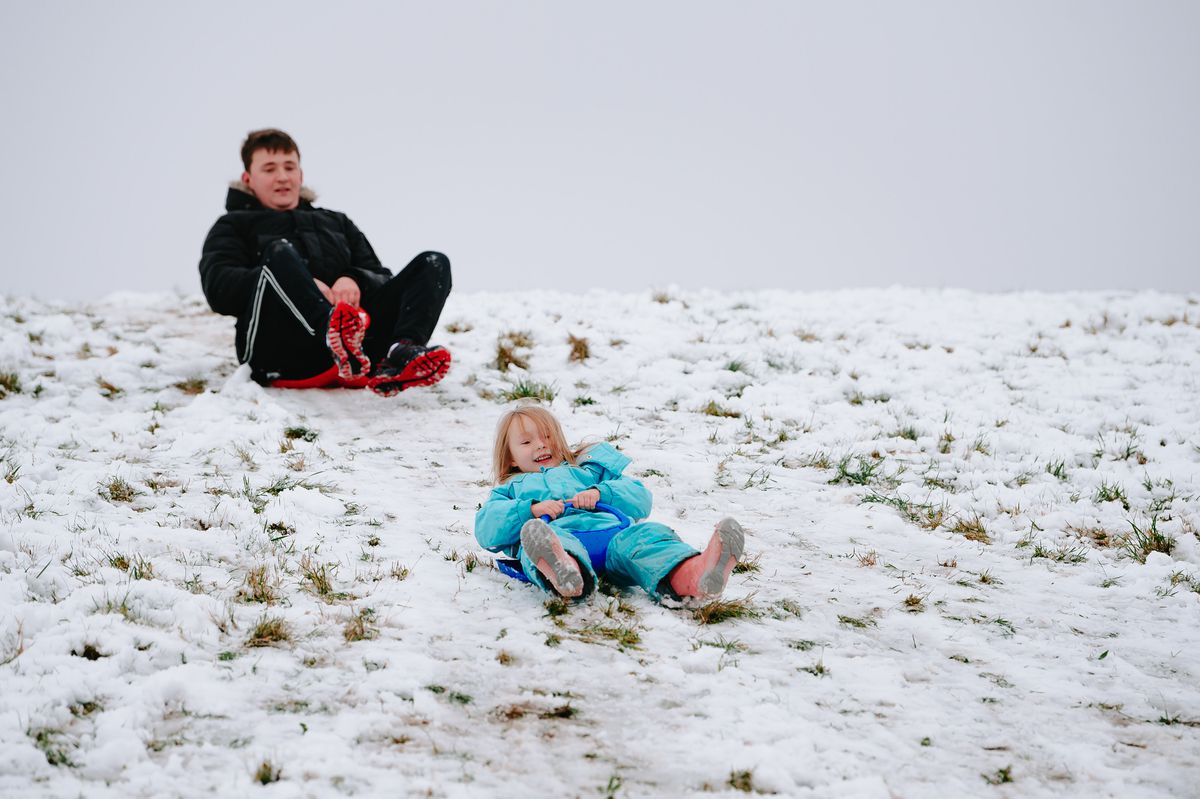 Ethan Perkins and four-year-old niece Polly Wright enjoy the snow in Milking Bank Park, Dudley