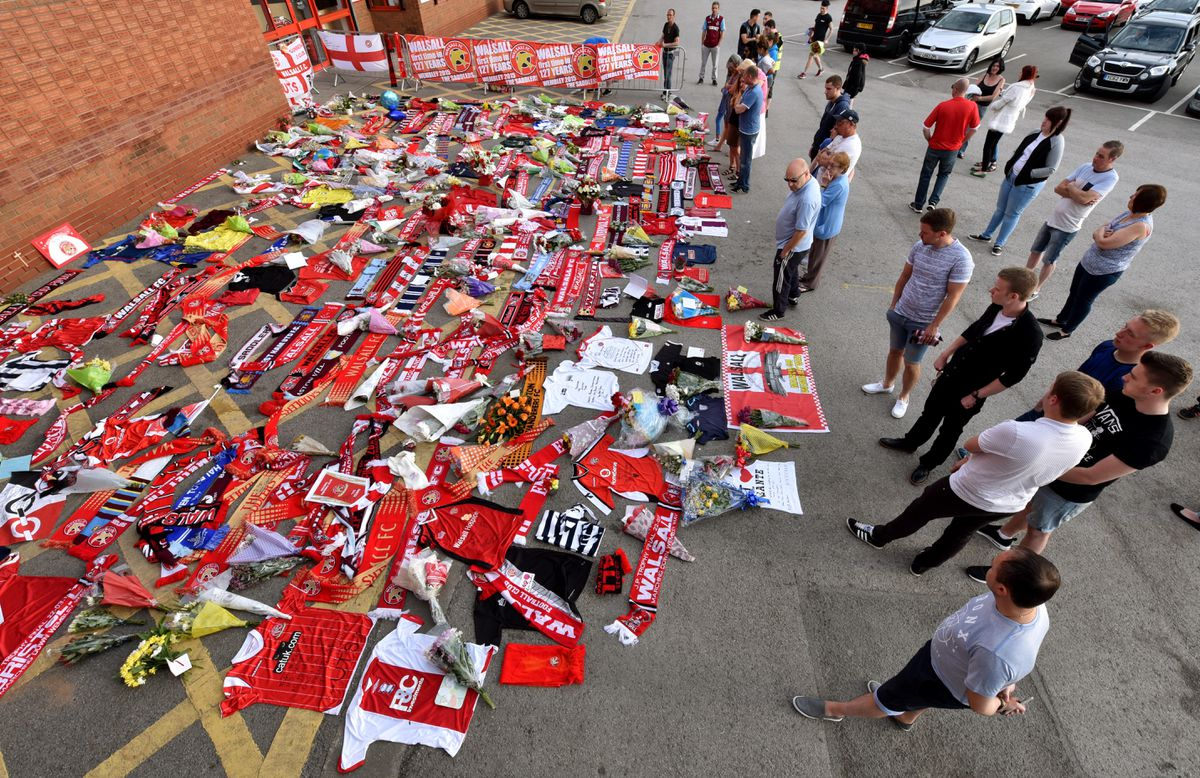 A huge amount of tributes laid next to the entrance of Walsall FC's Bescot Stadium