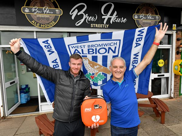 Brewhouse owner and Albion fan Colin Stephens with Chris Brunt