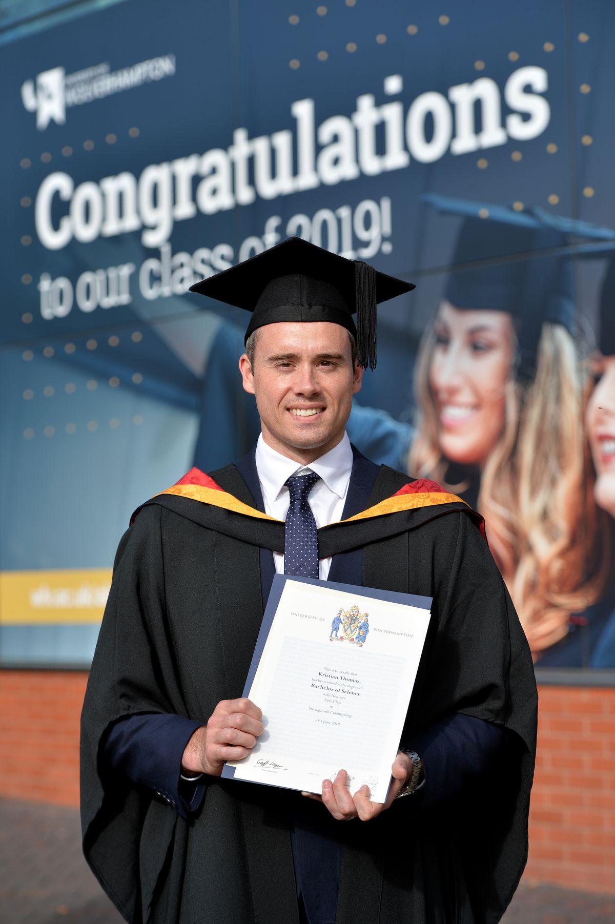 Kristian Thomas celebrates after receiving his degree