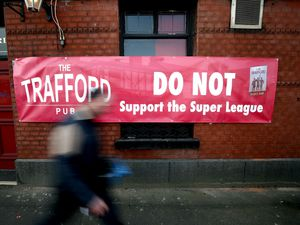 A banner outside of the Trafford pub in Manchester objecting to the decision of Manchester United joining the European Super League