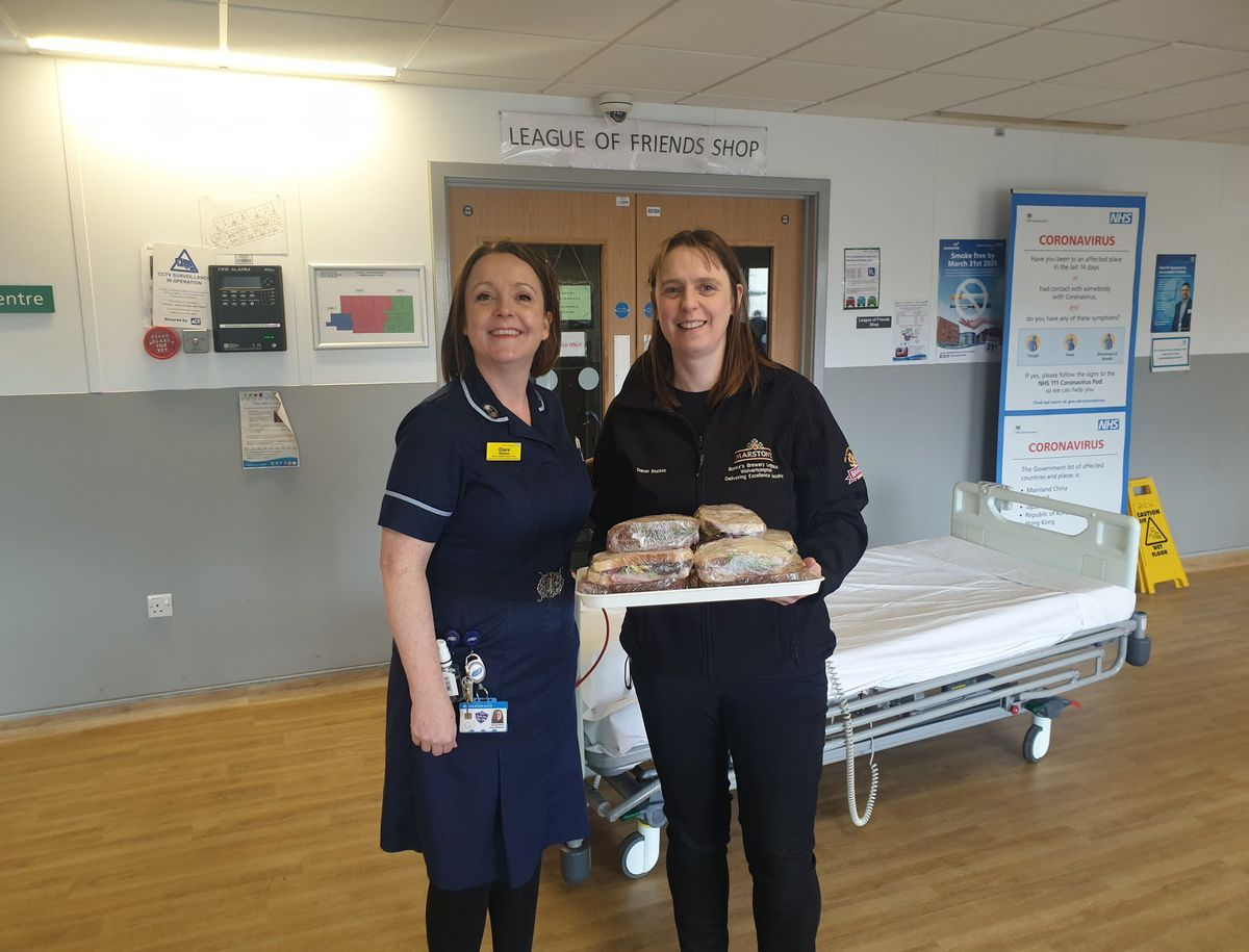 Staff at Walsall Manor enjoy some of the sandwiches sent by Marston's