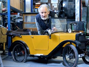 Alec Brew with a Austin seven 'Chummy' scale pedal car the same as the one featured in the TV show Brum