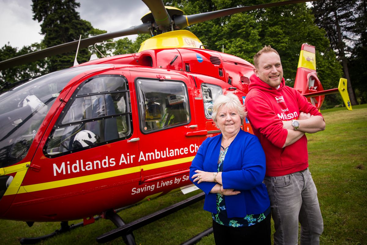 Two of the charity's volunteers with one of its aircraft
