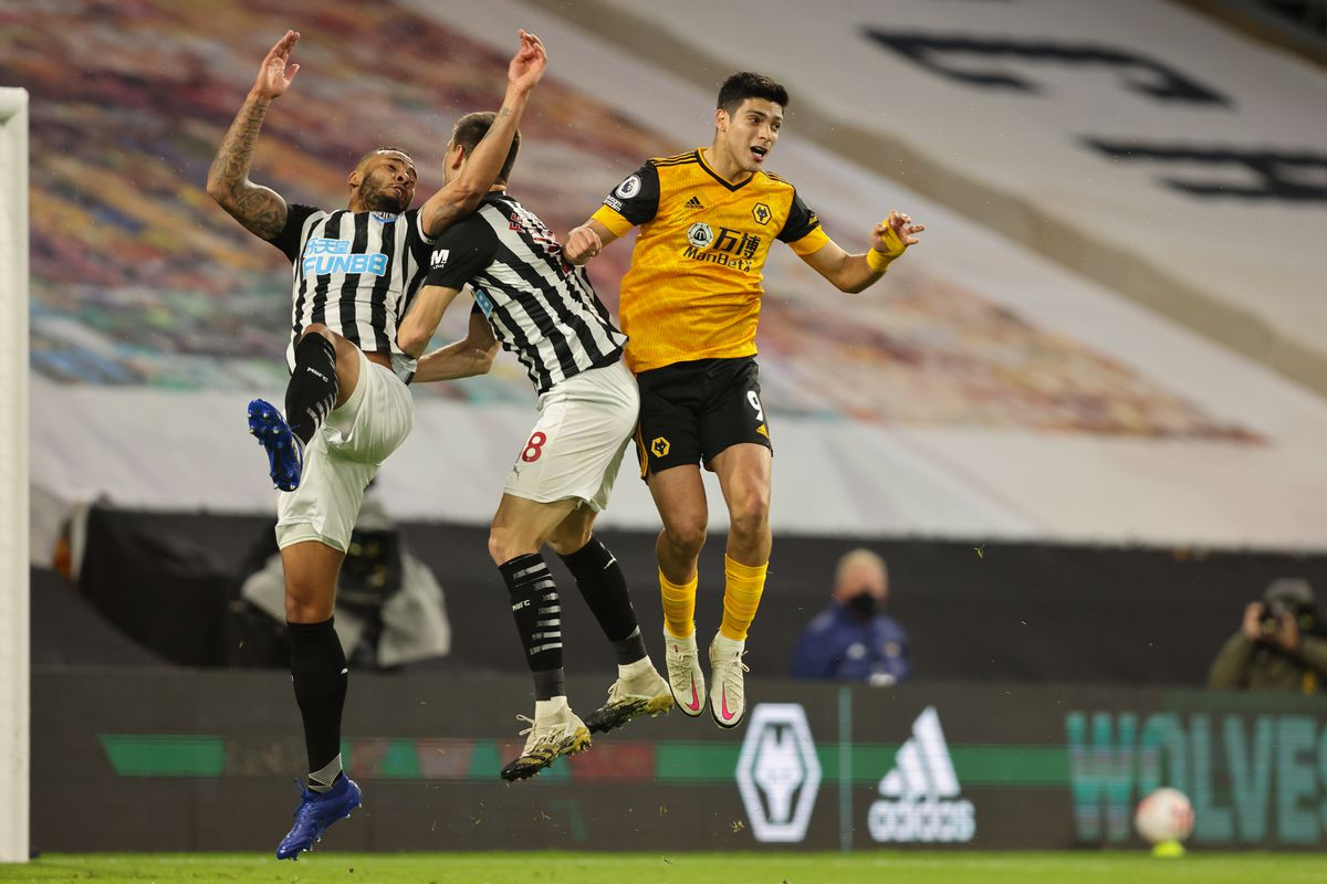 Jamaal Lascelles and Federico Fernandez of Newcastle United and Raul Jimenez of Wolverhampton Wanderers (AMA)