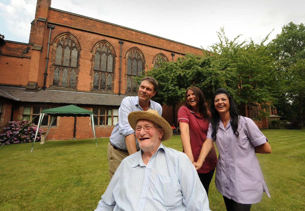 Mr Forrester with resident Michael Hall, nursing assistant Lucy Bates and care worker Carina Jenkins