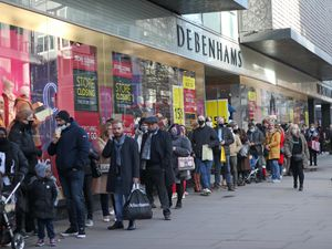 Shoppers queuing in Oxford Street, London