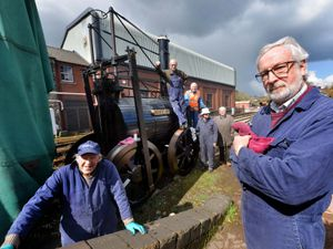 LAST COPYRIGHT SHROPSHIRE STAR STEVE LEATH 11/04/2021..Pic at Bridgnorth Severn Valley Railway, where a group of men are working on a engine, the Catch me Who Can, originally designed and built by Richard Trevithick (his 250th birthday is coming up). L-R:Front L-R: Brian Jones (Bridgnorth),  Charles Lamont from Alcester,  back:, Allan Mackenzie from Telford, John Price from Bridgnorth and Michael Grocock. Mark Rigg from Bridgnorth..