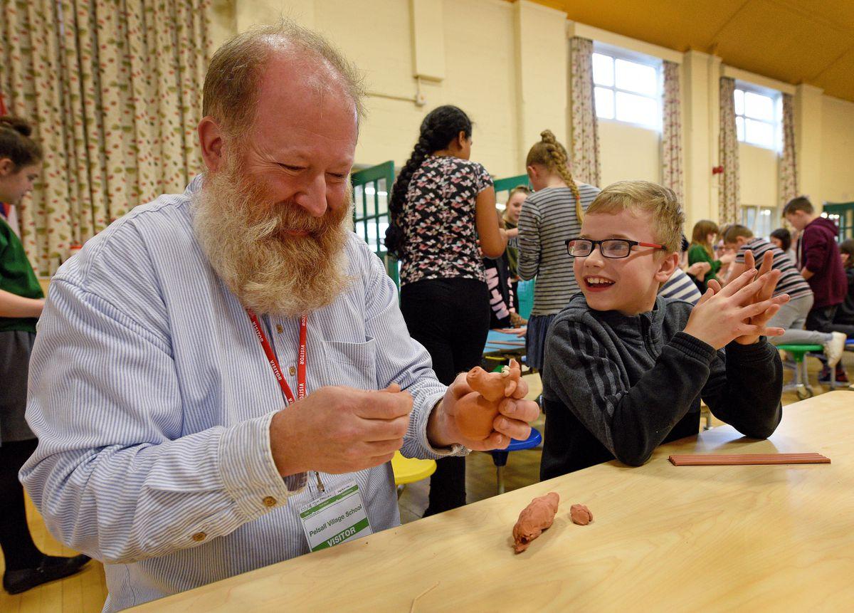 Senior model maker Jim Parkyn chats to Nathan Peck, aged 11