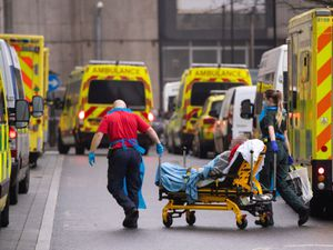 Paramedics unload a patient from an ambulance outside the Royal London Hospital in London.