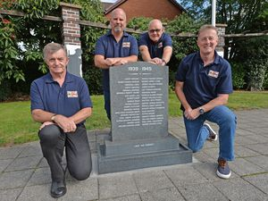Members of Short Heath Lest We Forget CIC at the memorial at the junction of Hayley Street and Straight Road, Lane Head