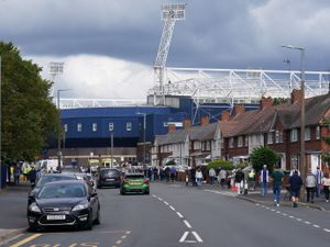 Fans walk along Halfords Lane ahead of West Brom's match against Millwall. Photo: AMA