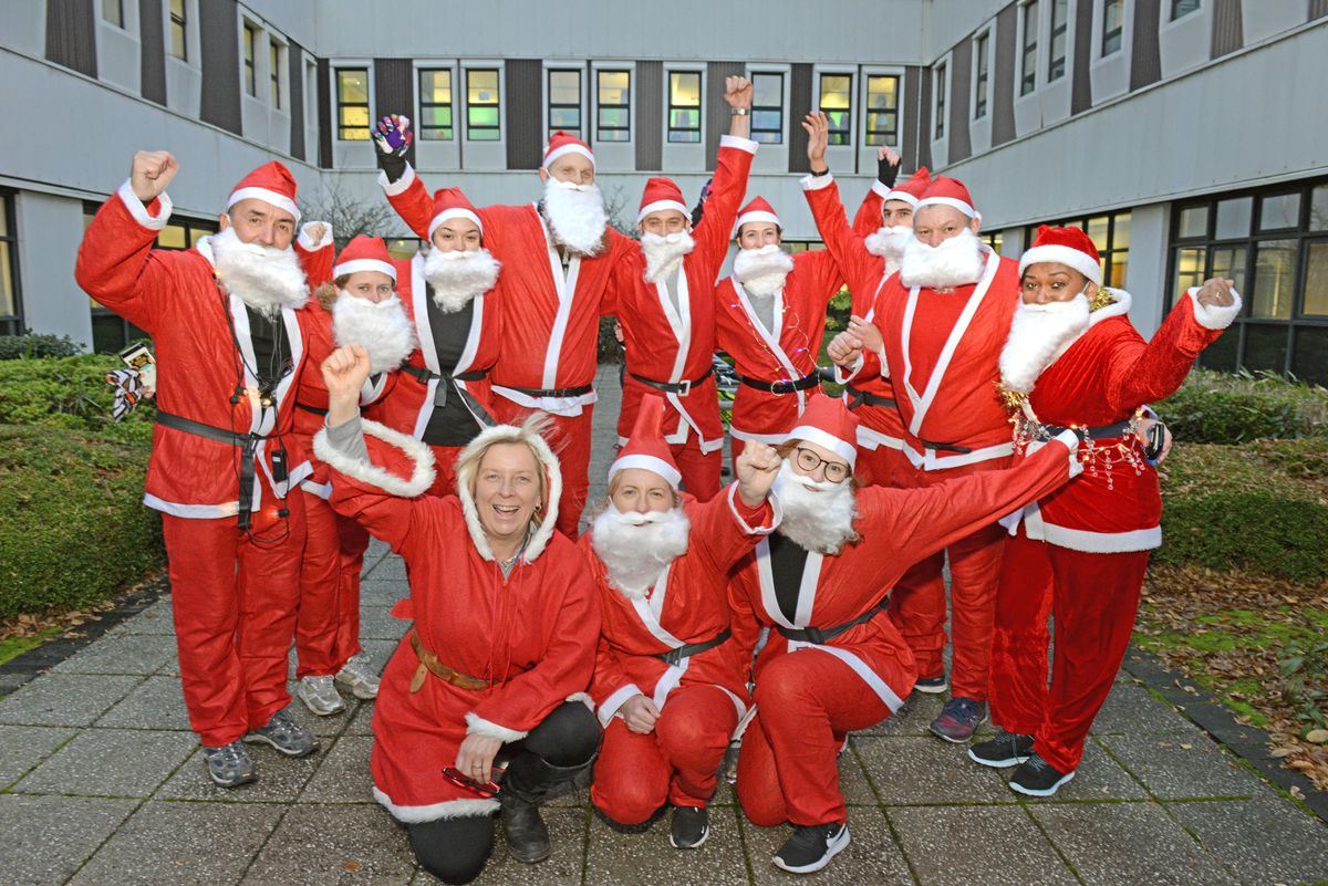 Helen Board, Cheryl Willetts and Sheri Pollet along with fellow Santas as they get ready for the Santa Dash at Russells Hall Hospital.