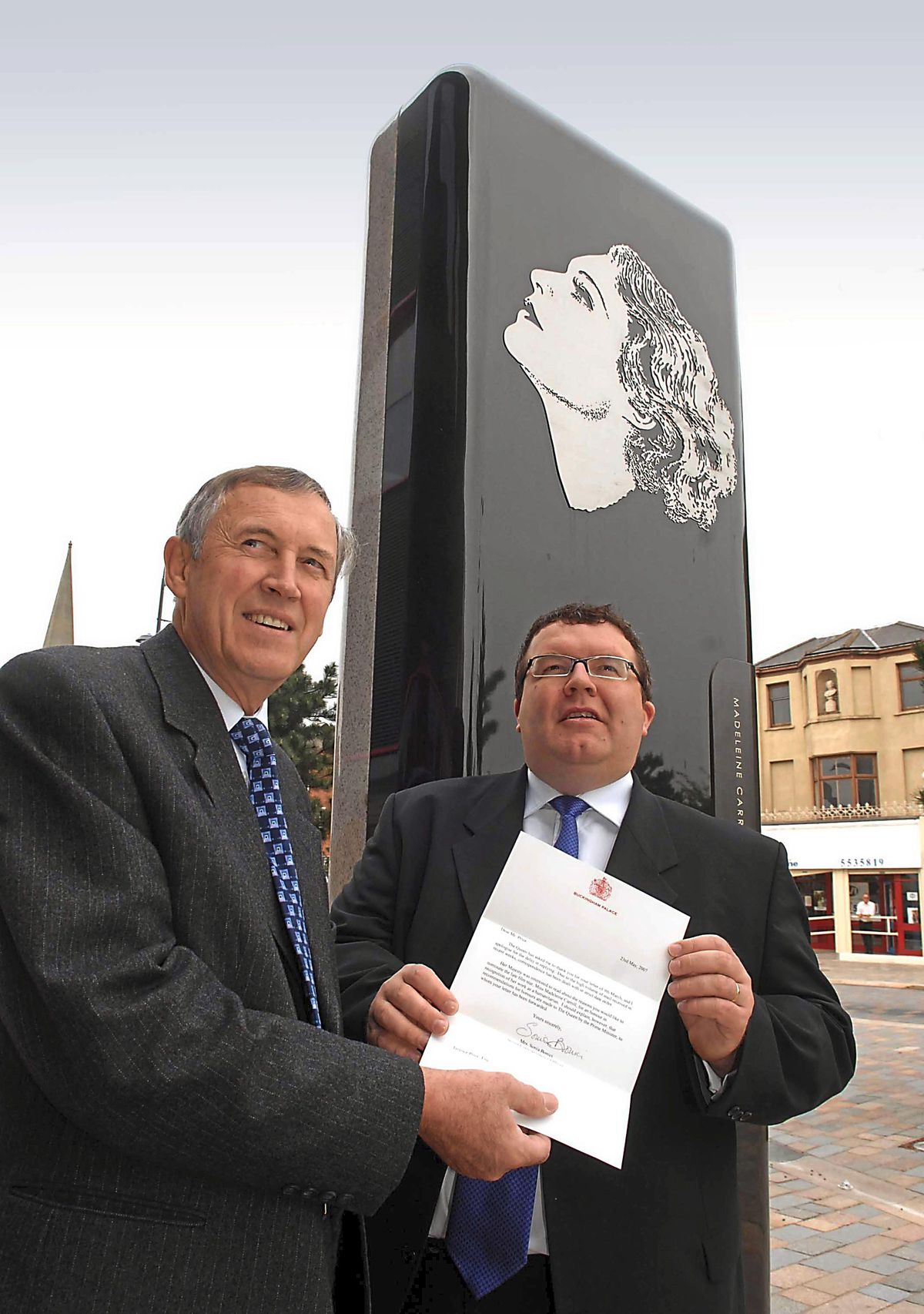 Terry Price and then MP Tom Watson by the memorial to West Bromwich-born film star Madeleine Carrol