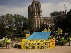 Homeless people need a roof too, say protesters outside Notre Dame