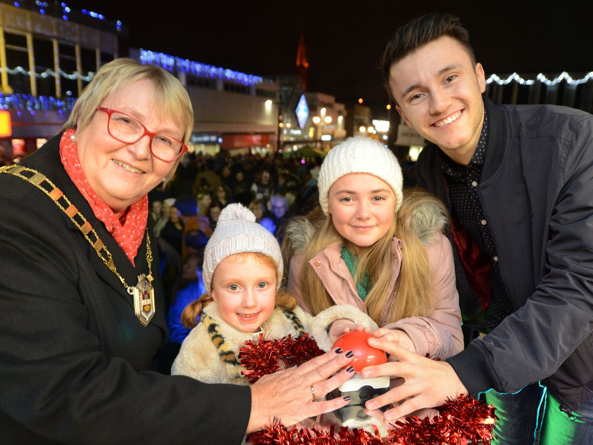Left to right: Hilary Bills, deputy mayor of Dudley, six-year-old Sarah Williams, 10-year-old Pheobe Glover and actor Gregory Piper