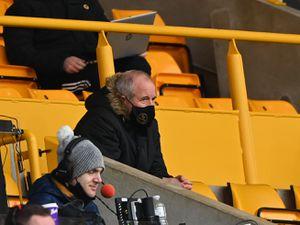Steve Bull looks on.
