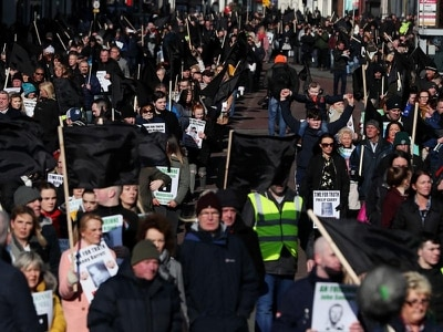 Victims of Troubles killings march for justice in Belfast
