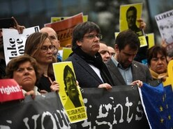 Ex-Catalan leader Carles Puigdemont joins protest in Brussels