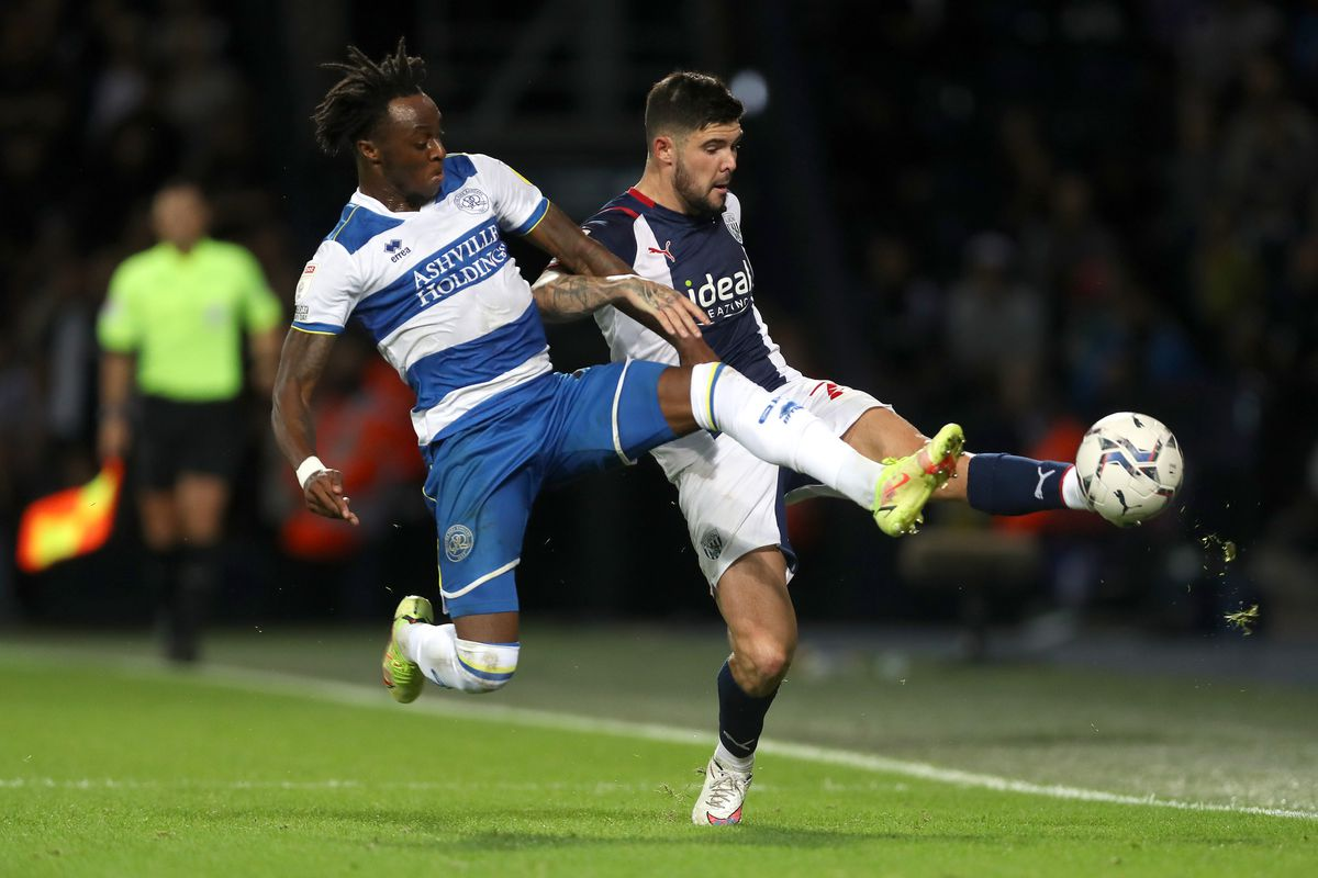 Moses Odubajo of Queens Park Rangers and Alex Mowatt (Photo by Adam Fradgley/West Bromwich Albion FC via Getty Images).
