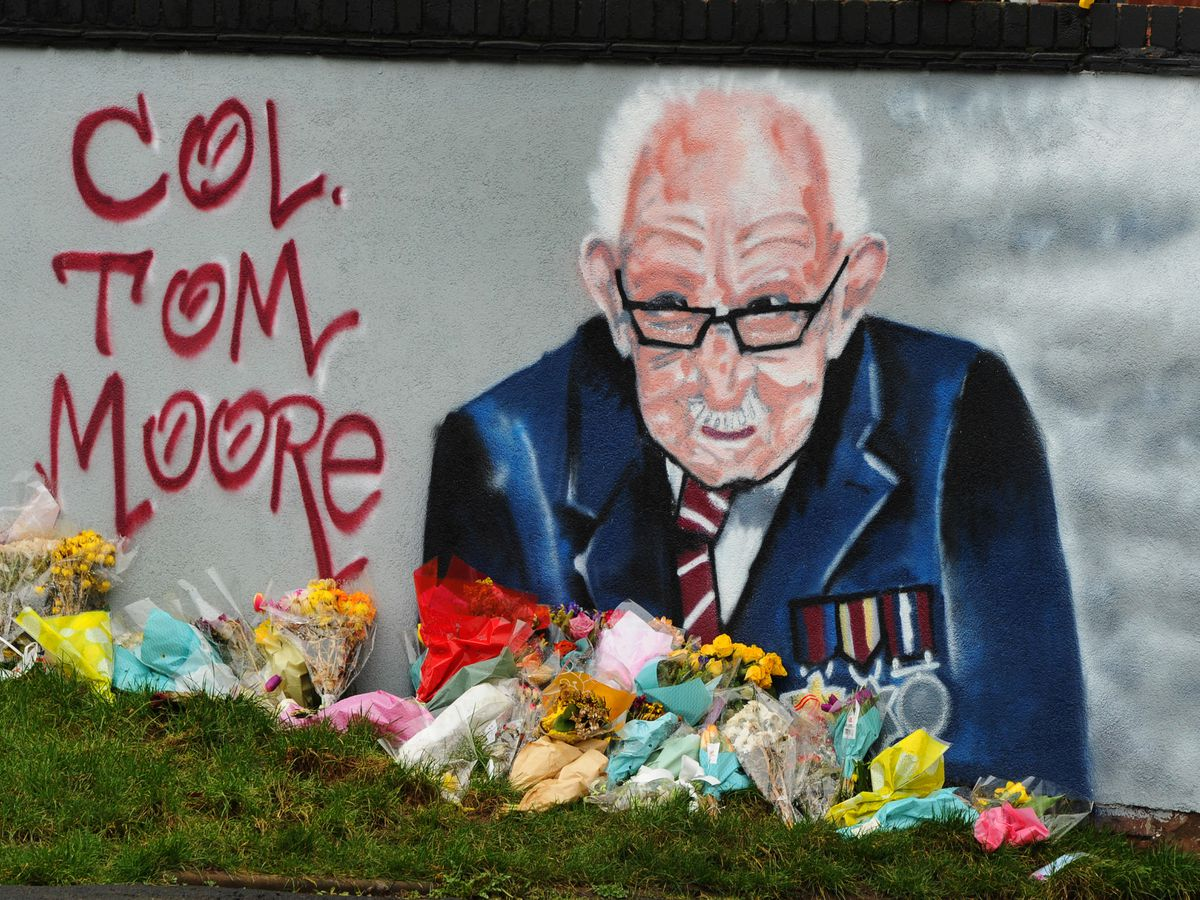 Flowers have been left at the mural to Captain Sir Tom Moore