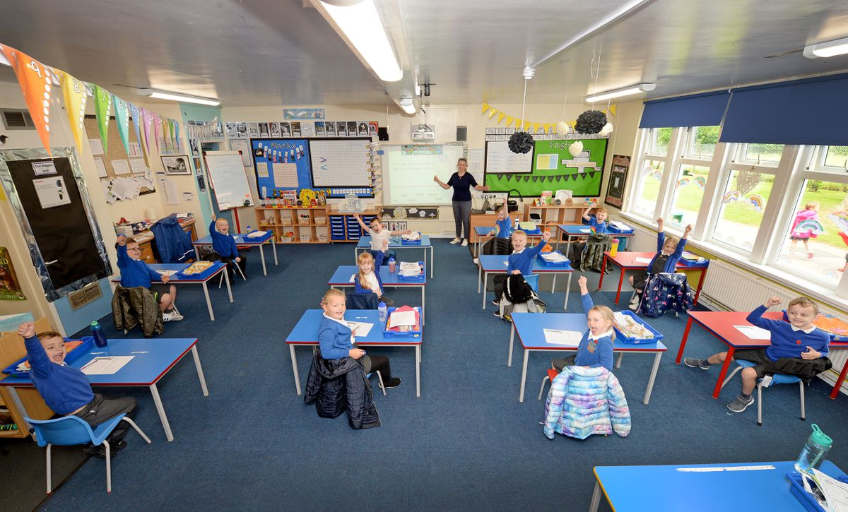 Teacher Claire Williams and Year 1 children at Landywood Primary School, Great Wyrley, which has seen 90 per cent of the pupils back at the school