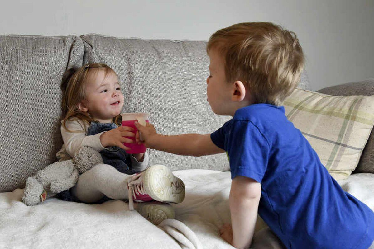 Evan brings his sister a drink