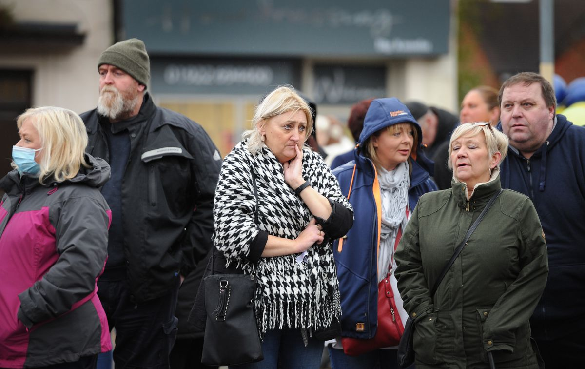 People line the street for Michael Hewitt's funeral procession