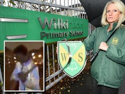 WATCH: Hammer vandals smash up school sign and car windows