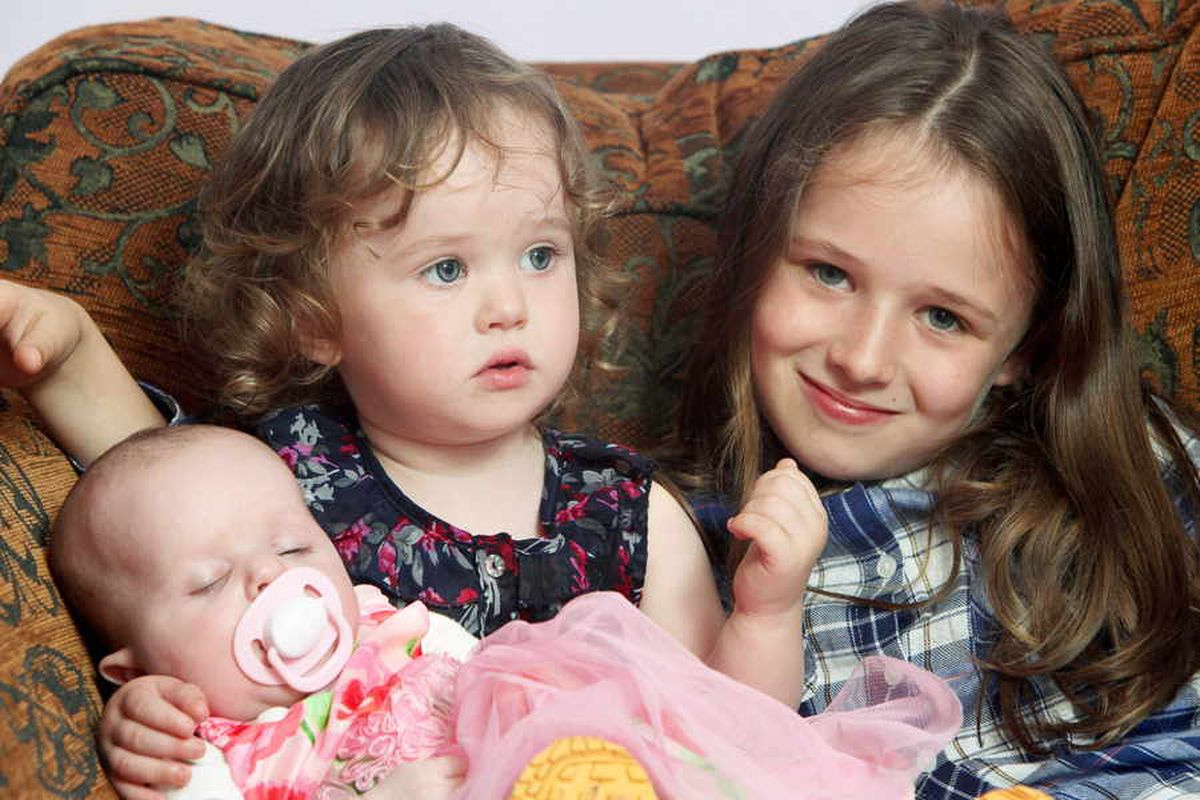 Before the midwife arrived, Francesca delivered her baby sister Saoirse who weighed a healthy 6lbs.  Mini-midwife Francesca fetched towels and even held baby Saoirse's head when she was born facing the wrong way round.