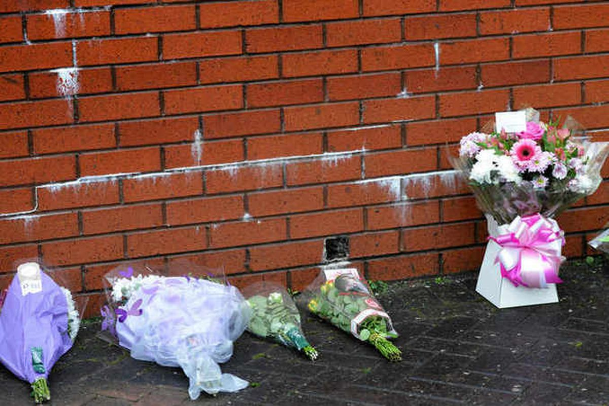 Flowers left outside the house in tribute to Jackie Abbott