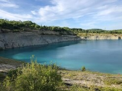 Two rescued as 60 people gather at disused 'blue lagoon' quarry pool