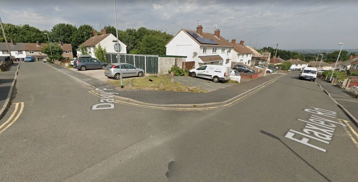 A Google Street View image of the garage block on the corner of Flaxley Road and Davy Place in Rugeley