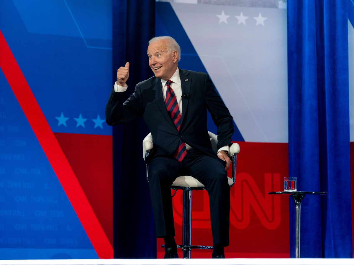 President Joe Biden interacts with members of the audience during a commercial break for a CNN town hall at Mount St Joseph University in Cincinnati